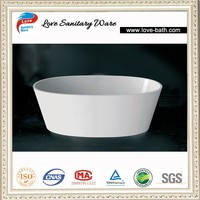 Free standing soaking solid stone bathtub in white color