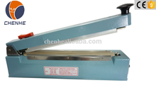 SF-300 Hand Impulse Sealing Machine With Aluminum Body With Middle Cutter