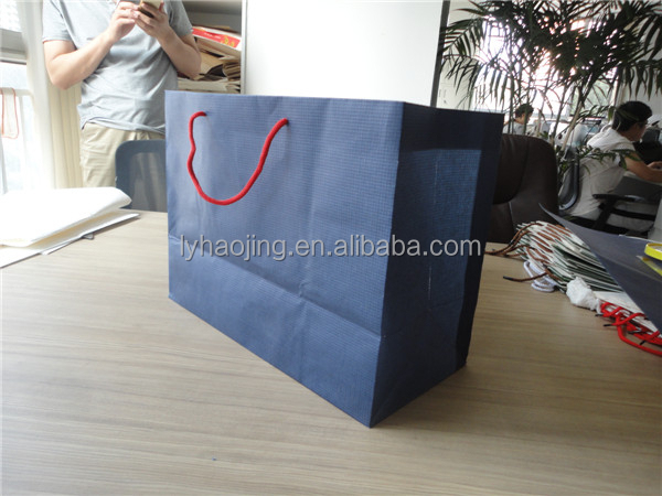 Customized fashion design shopping kraft paper bag with ribbon handle