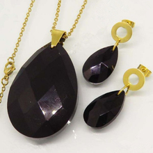 Beautiful drop shaped black stone stainless steel gold plated jewelry set with necklace and earrings