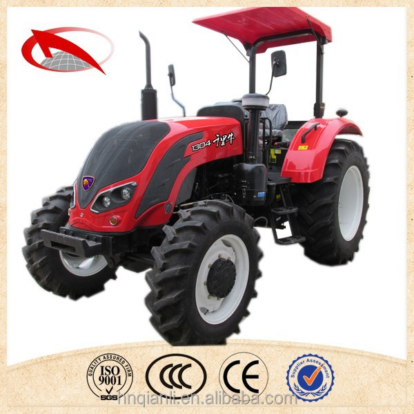 QLN 1254 big farm tractor with front end loader and backhoe