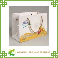 New design paper hand bag with deep space and golden handle for health protection products