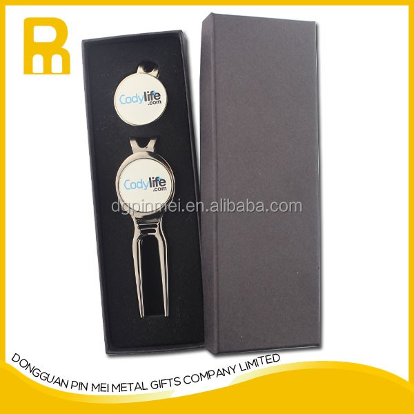 Golf divot tool with ball marker presentation box package
