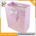Recyclable Light Pink Custom Gift Bag Paper Die Cut Handle Paper Bags With Bowknot