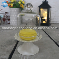 clear glass dome cake stand lemon macarons cover