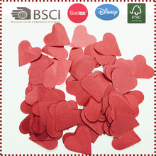 Heart shaped red or white paper confetti for wedding decoration