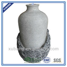artifical bold strip tall jar with rocky base fountain decoration