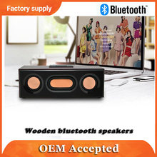 wooden outline with powered bluetooth speaker concert or home use