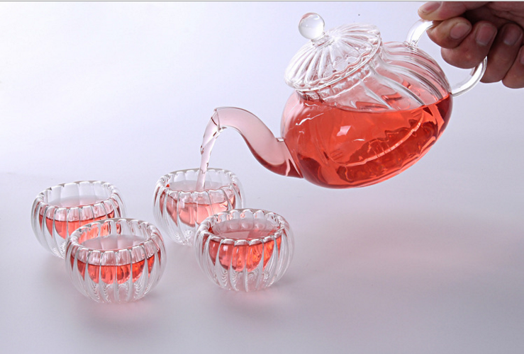 Pumpkin shape 1Glass teapot +4 double walled cups +1 warmer base +candle