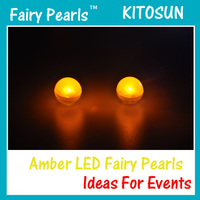 wire ornament hangers or fishing line can be attached battery operated floating amber fairy pearls