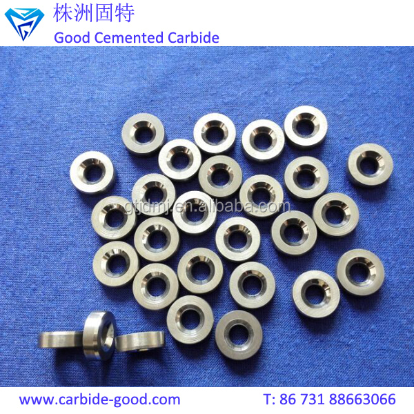 Discharge valve seat made from tungsten carbide