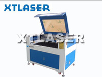 China mini co2 foam label laser engraving cutting machine for sale