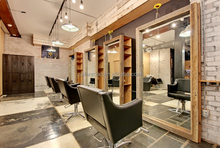 Barber shop worktables with mirror and chairs wall-mounted wooden shelves for beauty salon design