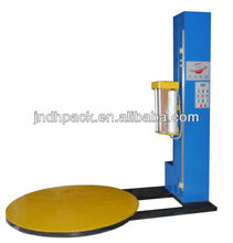 Construction materials pallet wrapping machine