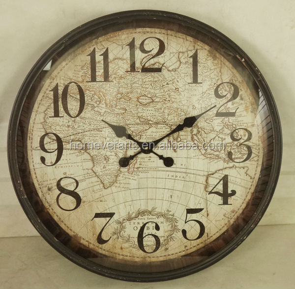 Antique black metal wall clock with arabic numberals dial