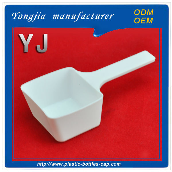 White square plastic washing powder spoon