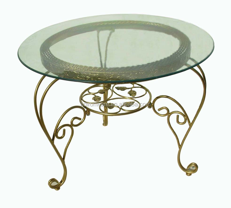Wrought iron round dining table buy round rotating for Rotating dining table
