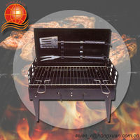 foldable BBQ charcoal grill with fork and spatula