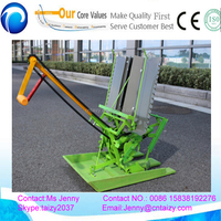 farmer use two row rice paddy transplanter
