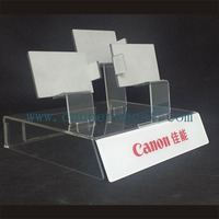 Clear acrylic camera retail display stand