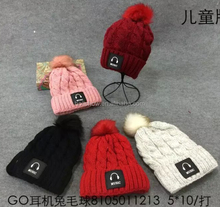 Hot Selling Fashion Music Earphone Label Sewed Twisted Baby Child Fur Bobble Hats