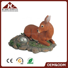 resin deer statue with solar garden lighting