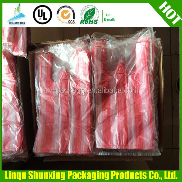 C folded t-shirt bags on roll / vest shopping bags / stripe bag manufacturing