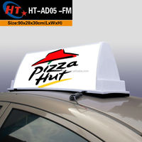 Taxi car roof top ad pizza sign light