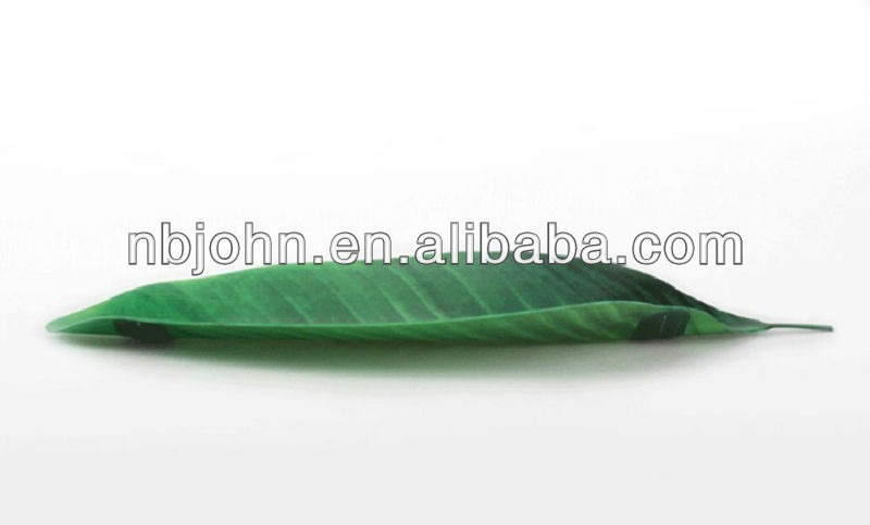 green plastic leaf shape candy plate