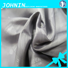 polyester cloth material customize logo textile 210T embossed taffeta lining fabric for mens clothing