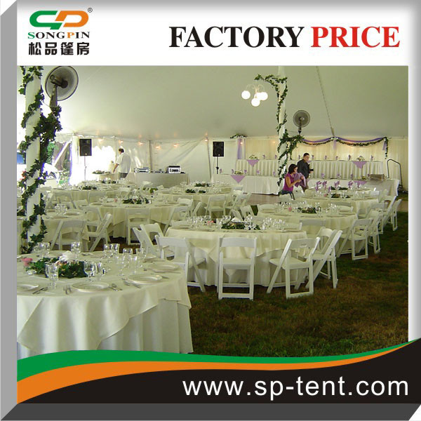 Corporate event Solid white 40'x40' pole tent set with tables and chairs and dance floor