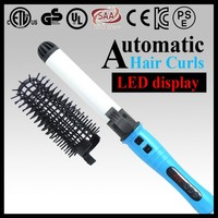 Lcd display dual voltage auto rotating hair brush with removable comb