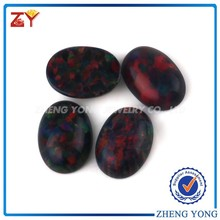 5x7mm Egg Shaped Flat Bottom Synthetic Black Fire Opal