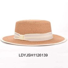 Women drinking straw hat with leopard print