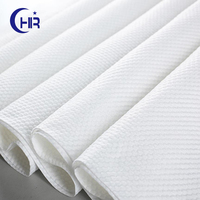 White spunlace nonwoven fabric plain and aperture or pearl pattern embossed