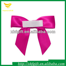 Rose pink satin ribbon bow with adhesive tape