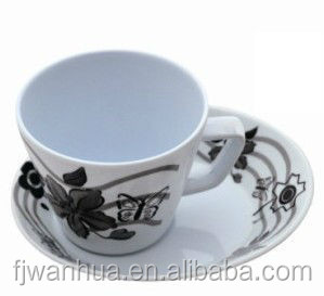 Plain white coffee cups and saucers