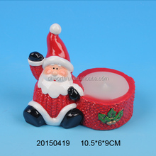 Handmade ceramic christmas candle holders with santa claus design