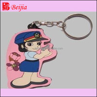 Wholesale sport girl rubber keyring/souvenir custom keychain with soft pvc key chain