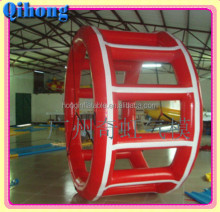 guangzhou Qihong crazy inflatable floating water running wheel toys for adults