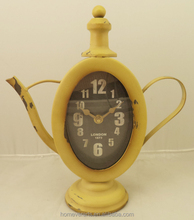 Antique yellow table teapot clock