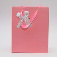 white ribbon bow pink paper bag with ribbon rope handle for gift bag