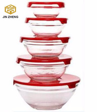 Transparent set of glass bowl with red color lids for sale