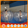 Colorful inflatable ball person inside human sized soccer bubble ball