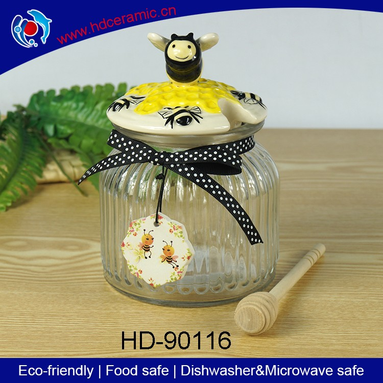 2016 Newest high quality transparent glass jar/ceramic honey jar/honey canister ceramic bee lid with wooden dipper