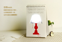 Creative fashionable USB page turning calendar LED table lamp for study