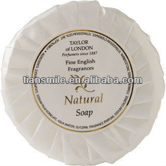 small white round disposable hotel soap
