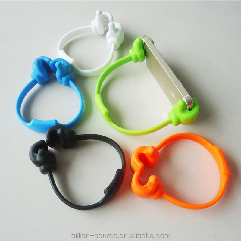 Plastic hand shaped cell phone holder for desktop