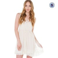 Women sitting pretty cream lace dress for clothing wholesale distributors