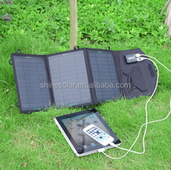 Foldable 19.5w solar panel charger with dual output for USB devices